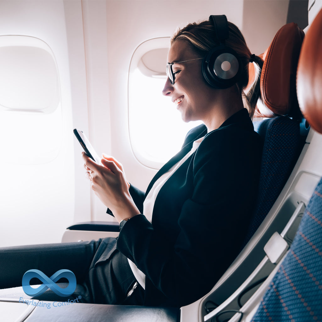 girl listening to music on the plane