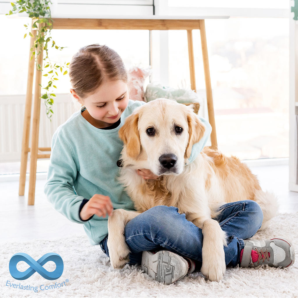 girl with dog playing on the floor