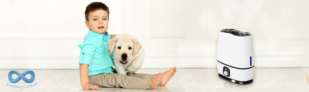 a boy with a puppy sit on the floor