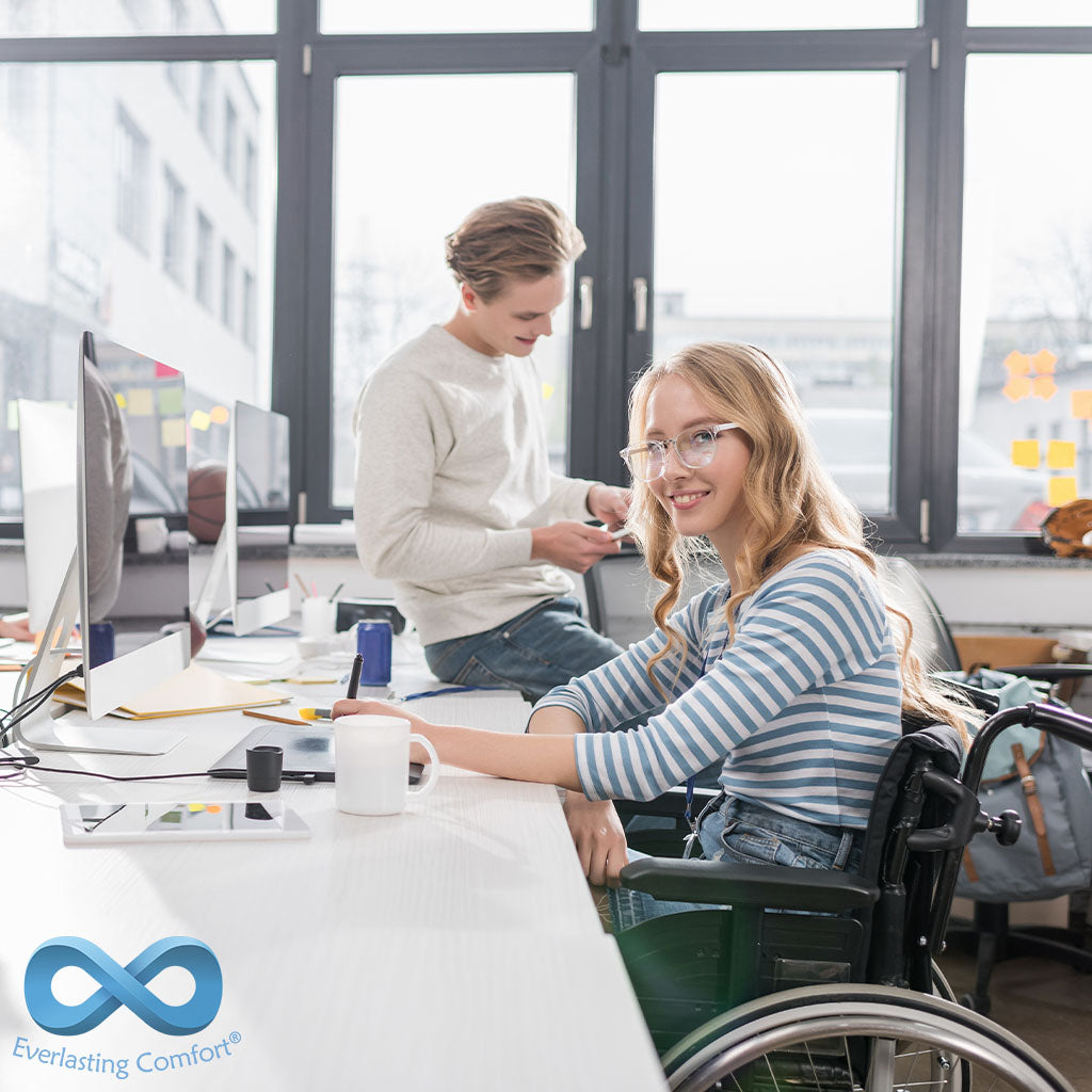 girl in a wheelchair working in the office