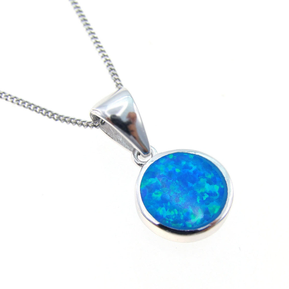 york new hp round halo blue roselle fire products elegant opal pendant