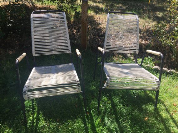 Pair of Stacking Mid Century Black Aluminum and Vinyl Strap Patio Lounge Chairs