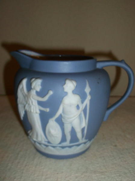 Blue and white pitcher with greek figures