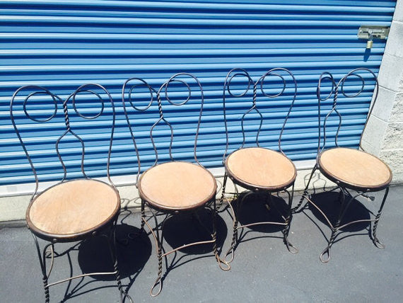 1930's Set of four ice cream parlor chairs and table set with twisted metal legs