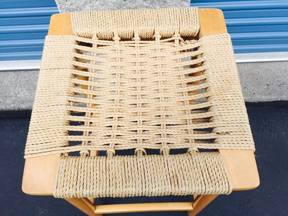 Vintage Danish Modern stool with woven rope seat  Mid Century Wegner Eames