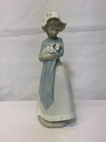 "NAO/ LLADRO, porcelain figurine ""Girl with a puppy dog."" SOLD- SOLD - SOLD"
