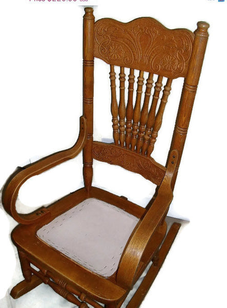 Early twentieth century press back oak wood rocking chair