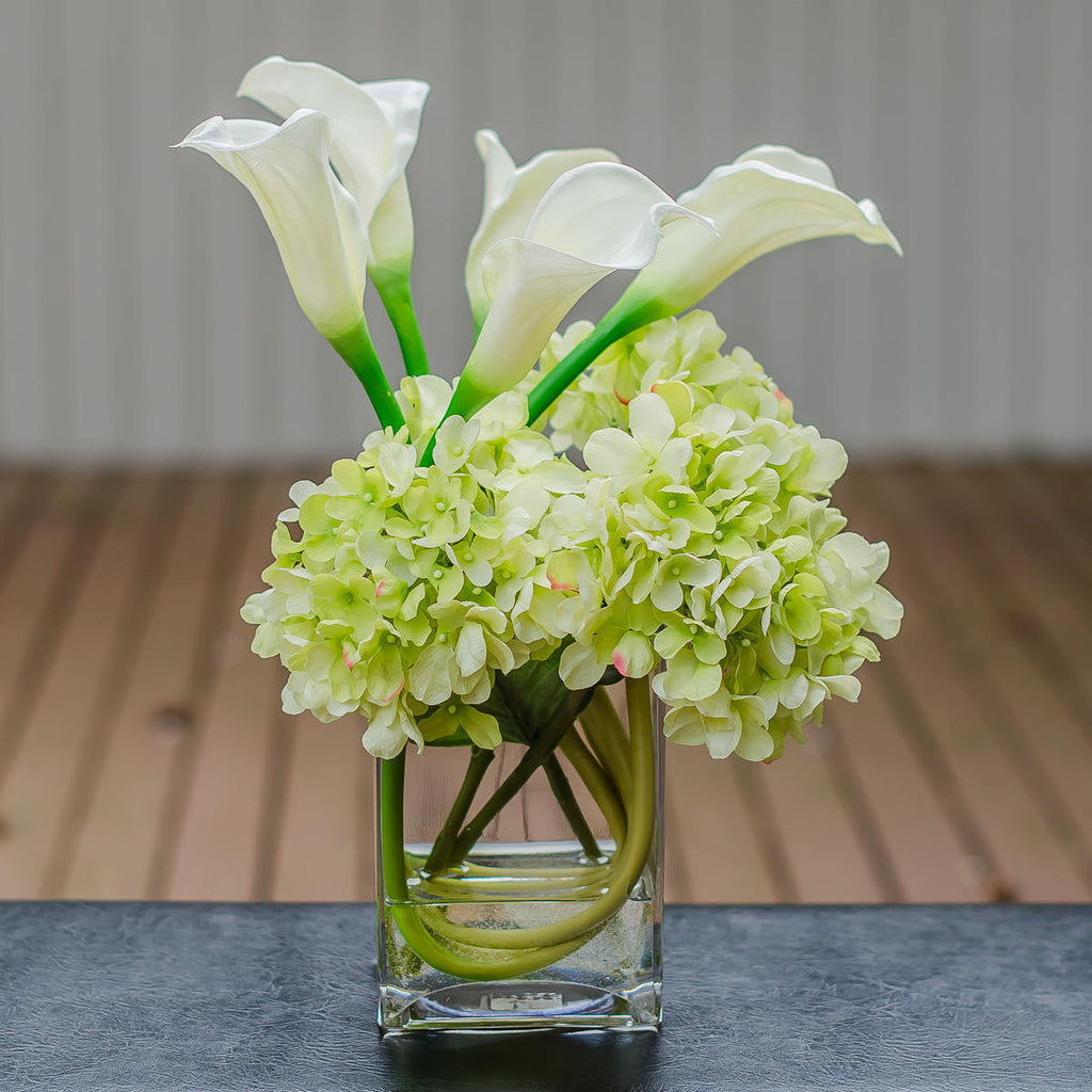 Silk green hydrangea with real touch calla lily arrangement flovery previous izmirmasajfo