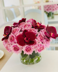Large elegant arrangement with 40 finest real touch purple roses and orchid