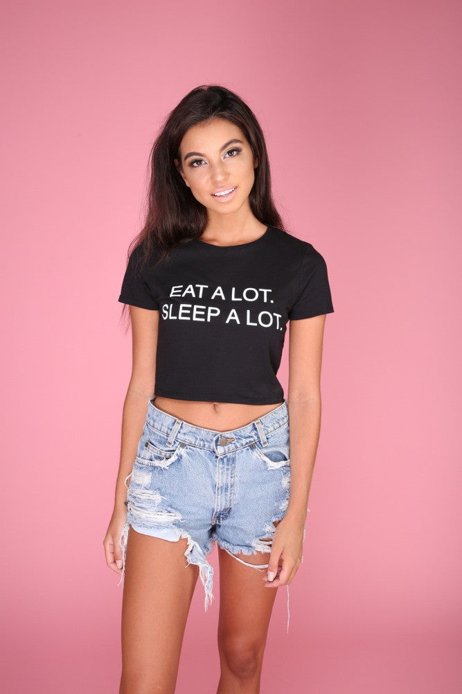 EAT A LOT. SLEEP A LOT. Black Graphic Crop Top