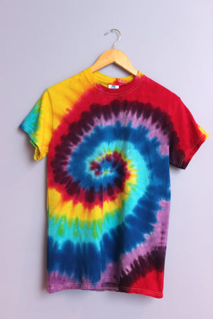 Vibrant tie dye t-shirt swirled with a multitude of colors including purples, blues, reds and yellow.