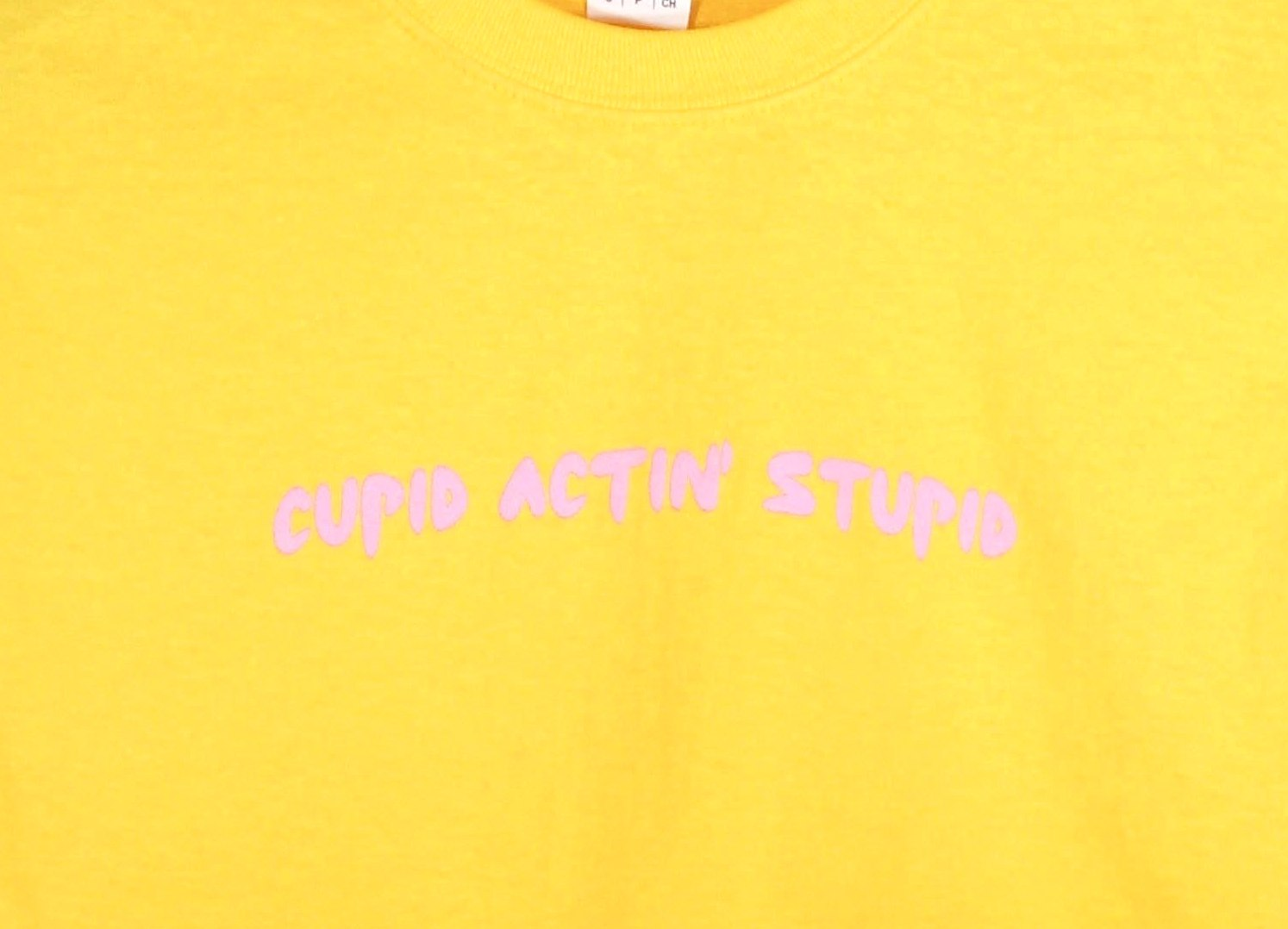Cupid Actin' Stupid Yellow Graphic Unisex Tee