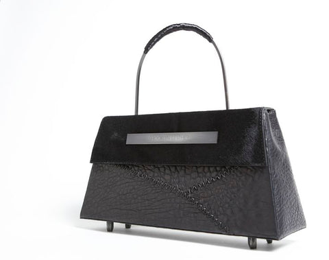 Eccentric leather dog accessories and custom luxury handbags.