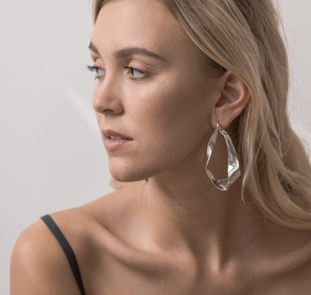 Sterling silver Cintas earrings inspired by satin ribbon