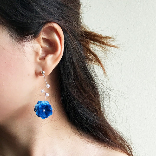 Blossom earrings are printed with 3D printer.