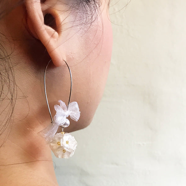 Japanese styled earrings that made with many small flowers.