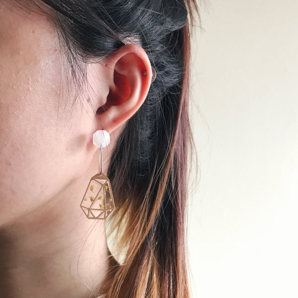 3D printed plastic earrings with real flowers.