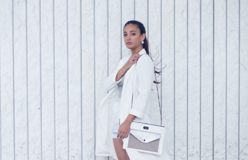 white outfit match with a bag
