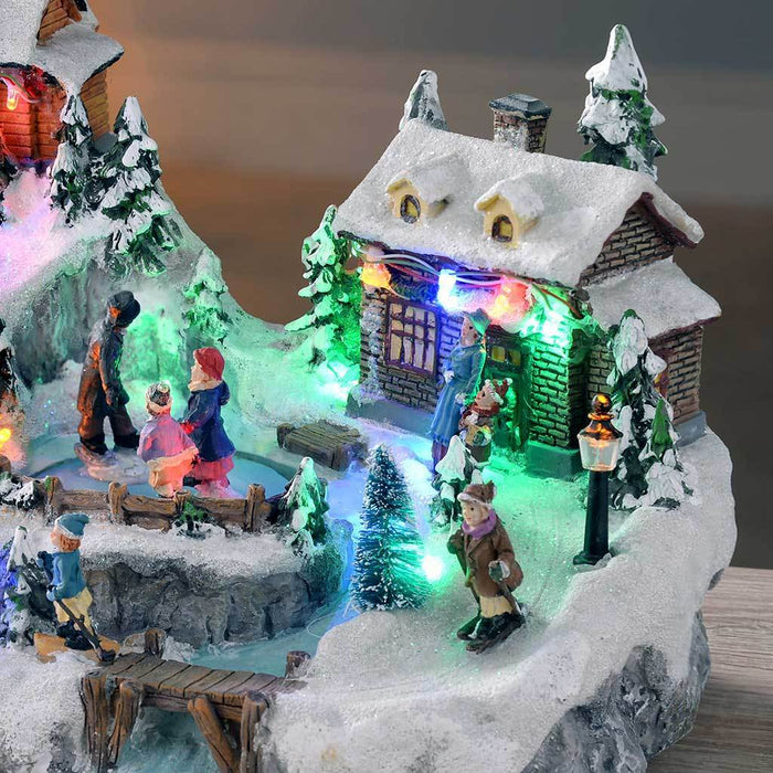 31 cm Animated Christmas Village with Moving Ice Rink and Slide/ Colour LED Lights