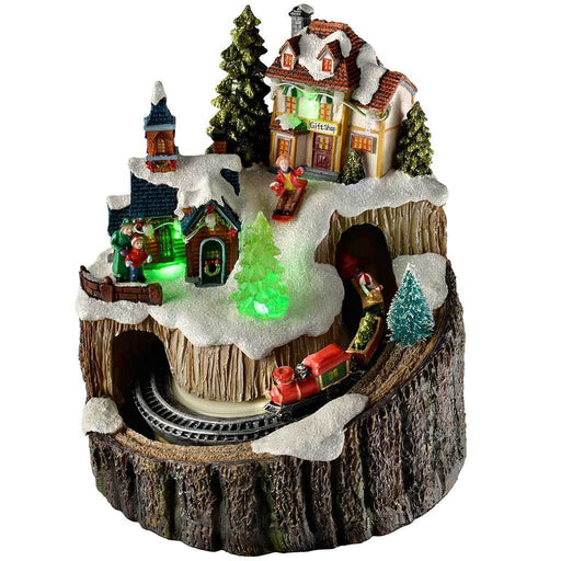 Pre-Lit LED Christmas Village on a Tree Stump with a Rotating Train, 20 cm