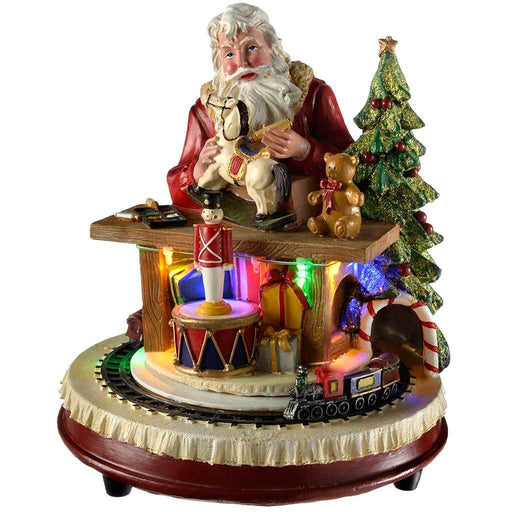 Pre-Lit LED Santa Sitting At His Desk with Rotating Train, 26 cm