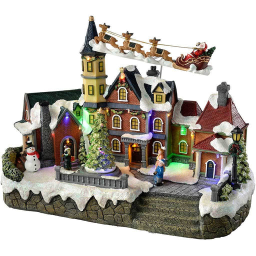 Animated Musical Village  Flying Santa and Rotating Christmas Tree Decoration,  41 cm