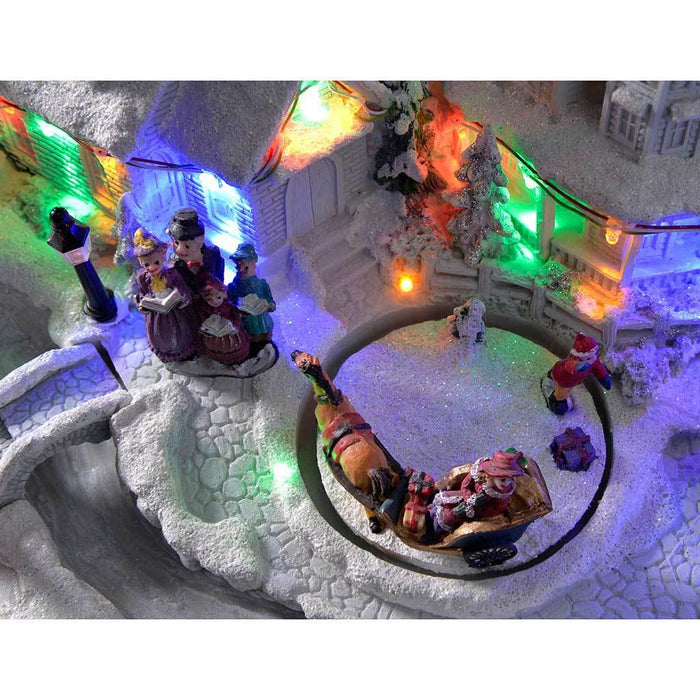 28 cm Pre-Lit Polyresin Village Rotating Figures Illuminated with Colour LED Lights