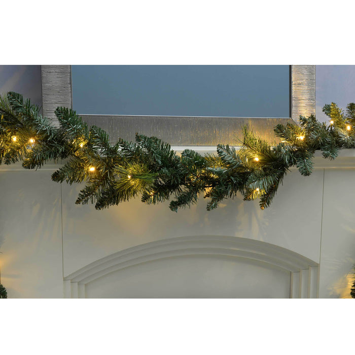 WeRChristmas Plain Pre-Lit Garland Christmas Decoration with 40 Warm White LED Lights 9 ft - Green
