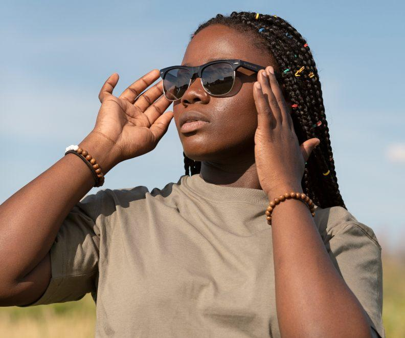 Woman wearing Kraywoods Black Jaguar, Clubmaster Sunglasses Featuring Ebony Wood Arms with 100% UV Protection, Polarized Lenses