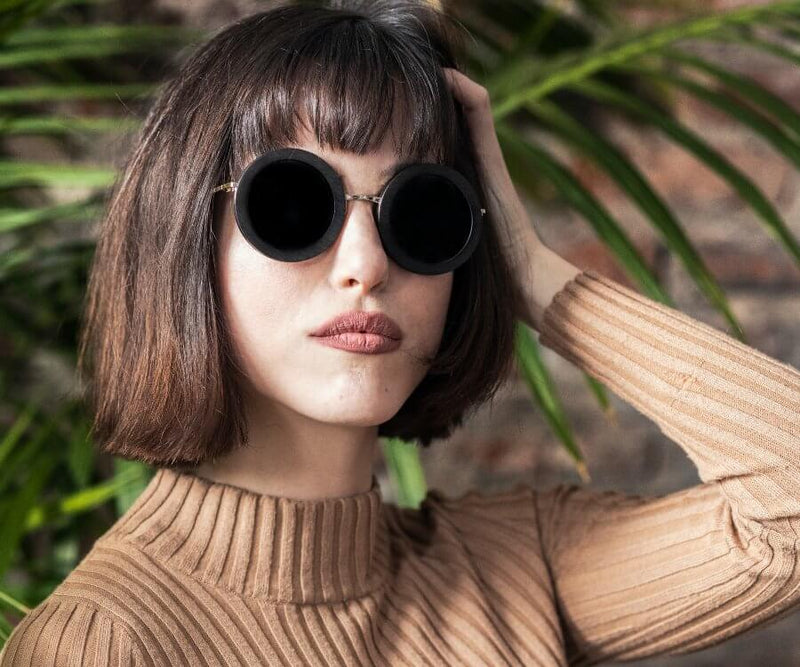 Woman wearing Kraywoods Birch, Oversized Round Sunglasses made from Ebony Wood with 100% UV Protection, Polarized lenses