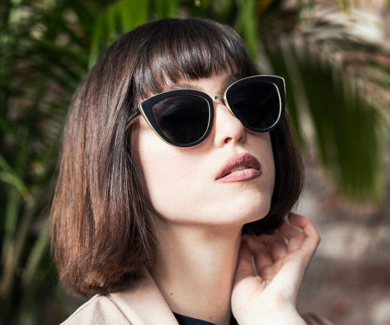 Woman wearing Kraywoods Willow, Bamboo Cat Eye Sunglasses Featuring 100% UV Protection, Polarized Lenses