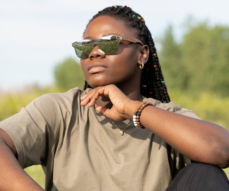 Woman wearing Kraywoods Rover, Silver Mirrored reflective Sunglasses featuring Zebra Wood Arms and 100% UV Protection, Polarized Lenses