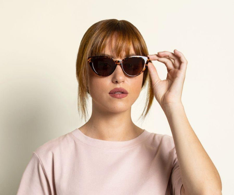 Woman wearing Kraywoods Stella, Tortoise Cat-Eye Sunglasses featuring Bamboo Arms and 100% UV Protection, Polarized Lenses