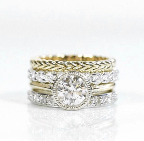 Heirloom redesign stack made with heirloom diamonds and mix of yellow and white gold