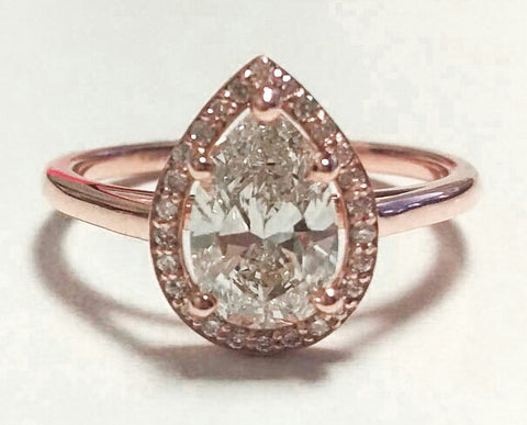 Custom rose gold pear shaped halo diamond engagement ring
