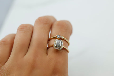 gray diamond ring paired with gray and white diamond stack ring yellow gold metal right hand rings or engagement rings