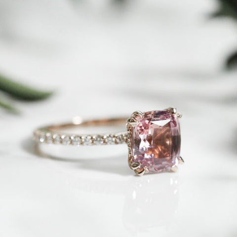 colored gemstone custom engagement ring in rose gold with diamonds on the band