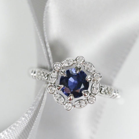 sapphire engagement ring with intricate diamond halo