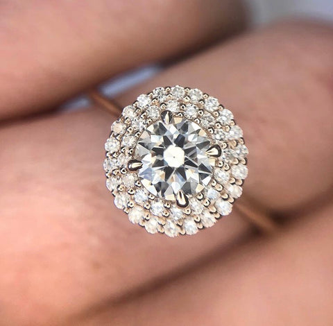 Round prong set heirloom redesigned diamond engagement ring with a double diamond halo and peach blend metal made with yellow and rose gold thin band