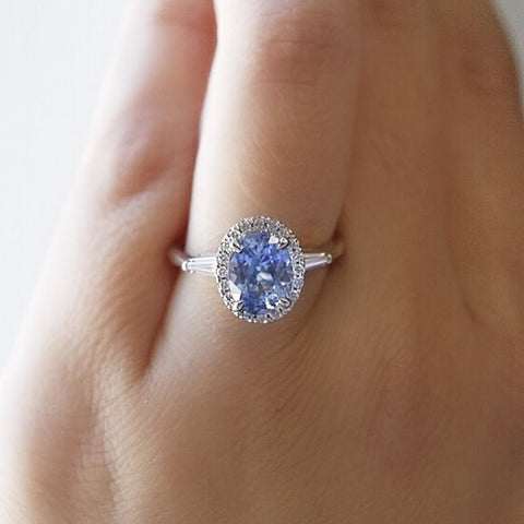 custom oval light blue sapphire diamond engagement ring with a diamond halo