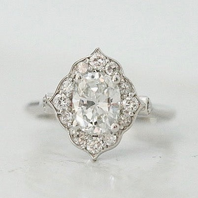 oval diamond engagement ring with intricate diamond halo