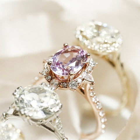 gemstone custom engagement ring with intricate diamond halo