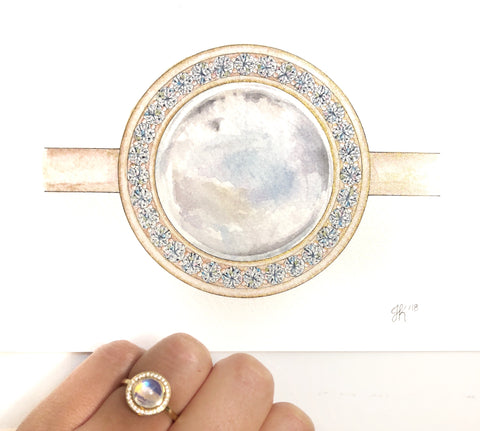 moonstone gemstone ring with diamonds and a yellow gold band in a watercolor painting