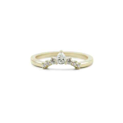 diamond and yellow gold contour wedding band with pear shaped diamond and round diamonds