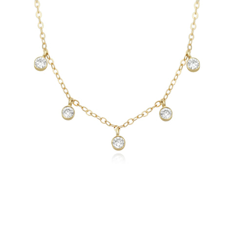 bezel set diamond layering necklace with a yellow gold chain