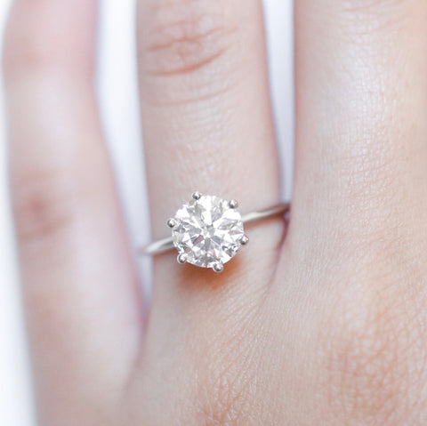simple setting white gold round brilliant cut diamond engagement ring