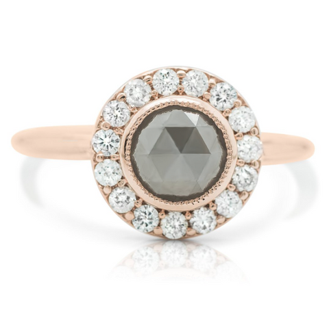 round gray diamond ring with rose gold band and white diamond halo