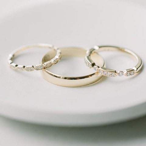 yellow gold and diamond stackable women's wedding bands and a simple yellow gold men's wedding band
