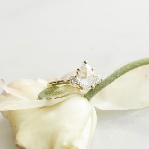 rose cut pear shaped diamond engagement ring with matching side stones
