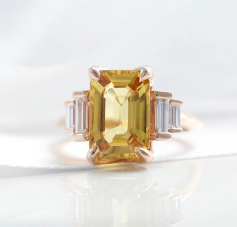 yellow sapphire and baguette diamond ring with a yellow gold band push present